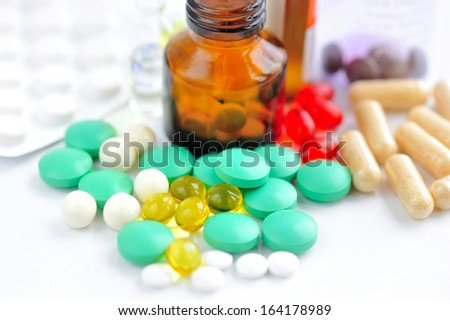 Color pills and medical bottle - stock photo