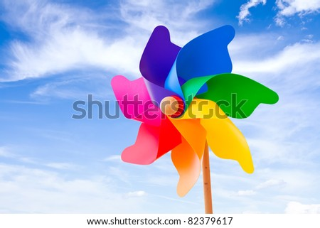 Color pinwheel against summer sky - stock photo