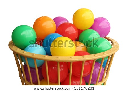 Color plastic balls in basket over white background - stock photo