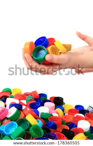color plastic caps in human hand as nice background