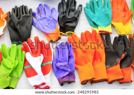 Color plastic gloves, closeup of photo