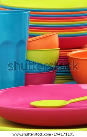 Color plastic tableware - stock photo