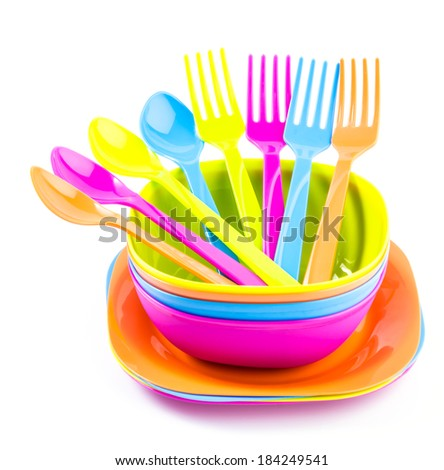 Color plastic tableware dishes , spoon , fork - stock photo