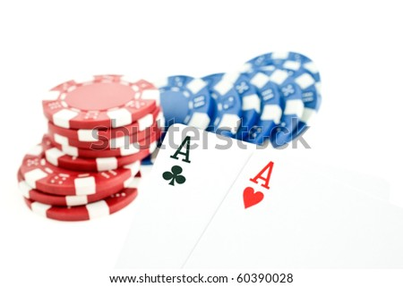 color poker chips and two aces cards on white background