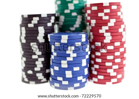 color poker chips heaps isolated on white background. closeup horizontal shot. another similar shots available