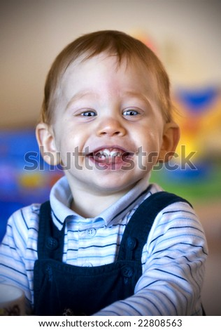 Color portrait of a baby boy with a big smile