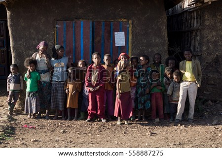 color portrait of black kids standing outside their house in africa, december 2015, oromia state, ethiopia