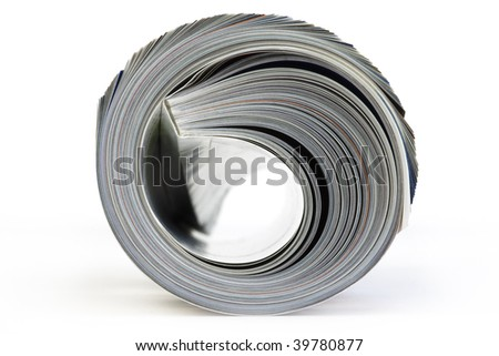 Color, rolled up Magazine. Close-up, front view. Isolated on white background. - stock photo