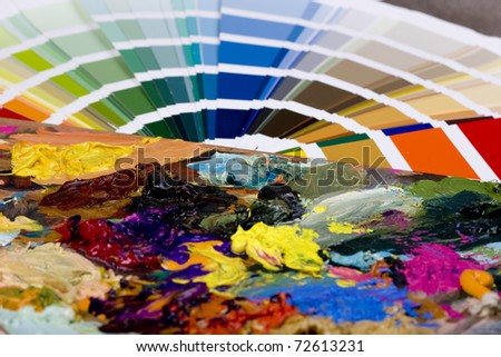 Color sampler compared to artistic paint - stock photo