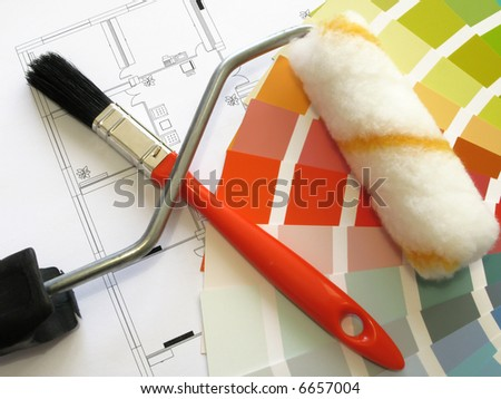 Color samples for selection and a roll and a painter´s brush with house plan on background - stock photo