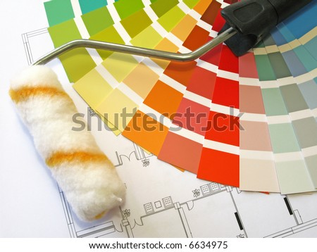 Color samples for selection and a roll with house plan on background - stock photo