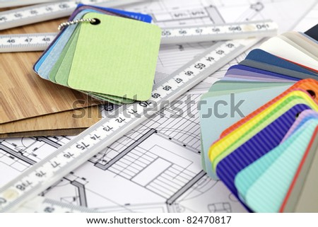 color samples of architectural materials - plastics,  metric folding ruler and architectural drawings of the modern house