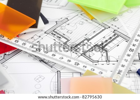 color samples of architectural materials - plastics,  metric folding ruler and architectural drawings of the modern house - stock photo