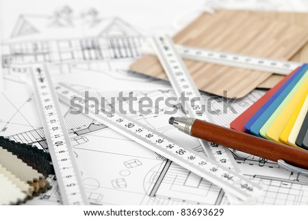 color samples of architectural materials - plastics,  metric folding ruler, pencil & architectural drawings of the modern house