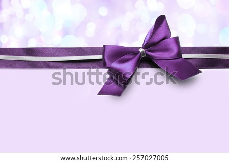 Color satin ribbon bow on bright background - stock photo