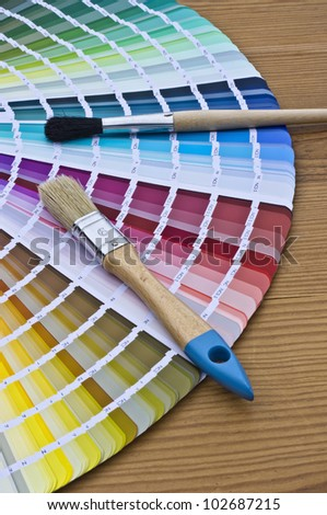 Color set with brushes on wood background