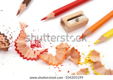 Color shavings and pencil with wooden sharpener with center - stock photo