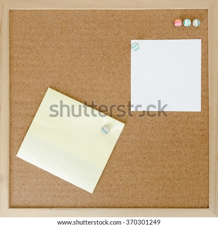 Color shot of a brown Cork board with blank notes. - stock photo
