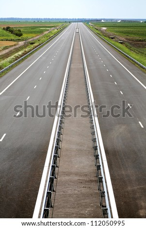 Color shot of a newly built highway with no traffic