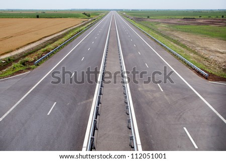 Color shot of a newly built highway with no traffic - stock photo