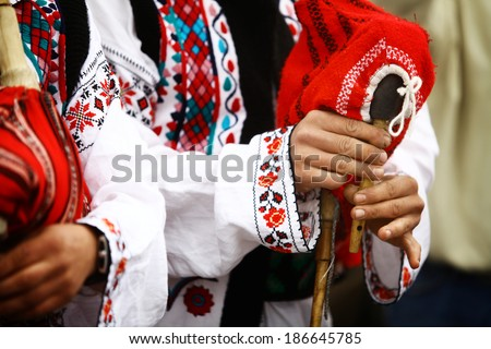 Color shot of a person holding a traditional Romanian bagpipe. - stock photo
