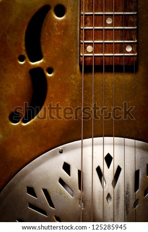 Color shot of a vintage dobro guitar - stock photo