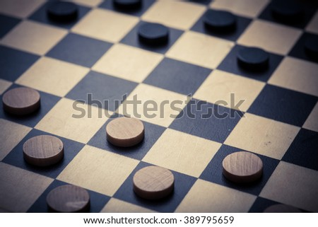 Color shot of a vintage draughts or checkers board game. - stock photo