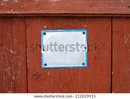 Color shot of an empty yellow white sign on a red wall. - stock photo
