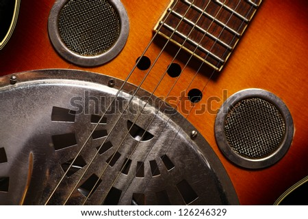 Color shot of an old vintage guitar - stock photo