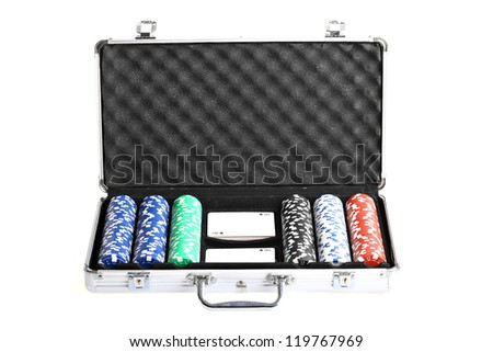 Color shot of an open briefcase containing poker cards and chips - stock photo
