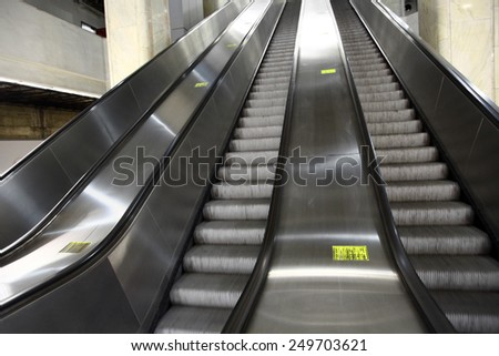Color shot of some escalators in a metro station. - stock photo