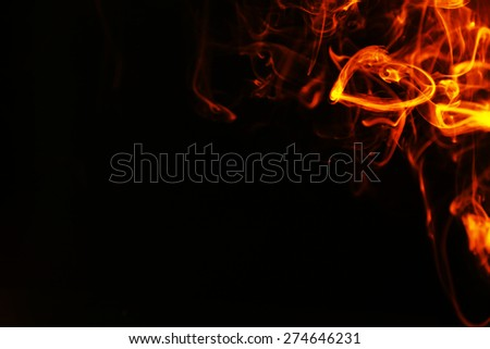 Color smoke from match on dark background - stock photo