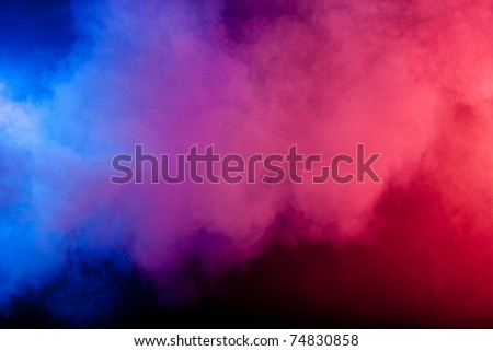 Color smoke on black background - stock photo
