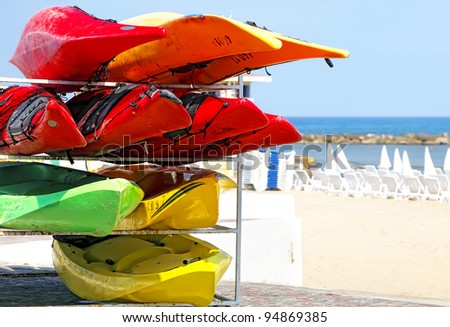 Color sports kayaks on the beach - stock photo