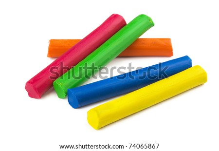 Color sticks of modeling clay isolated on white - stock photo