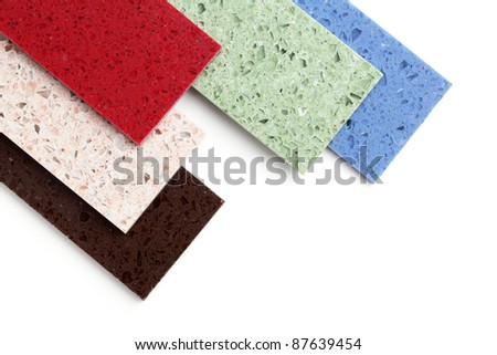 Color stone samples for kitchen worktops on white background. - stock photo