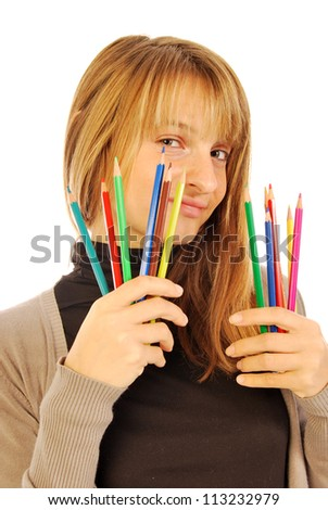 Color the world - 170 - A girl holds in hands of colored pencils - stock photo