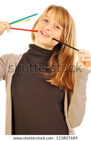 Color the world - 105 - A girl holds in hands of colored pencils - stock photo