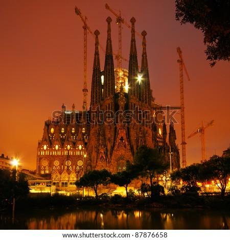Color toned night image of Sagrada Familia. - stock photo