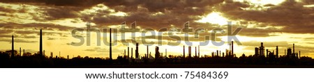 color toned panoramic picture of oil refinery at sunset - stock photo