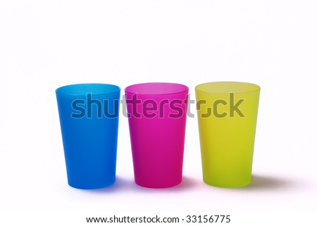 Color toothbrush holders on the white background - stock photo