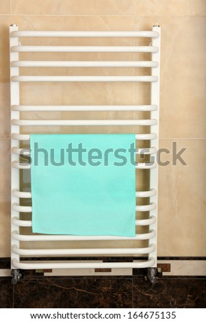 Color towel on  radiator in bathroom