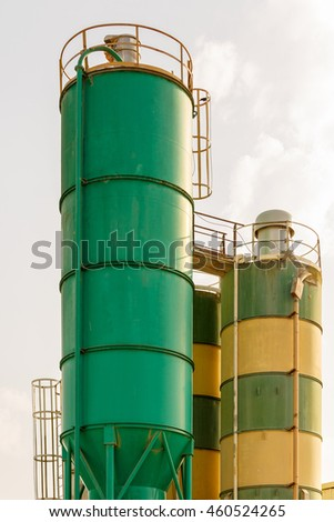 Color towers on chemical plant, green and striped cisterns