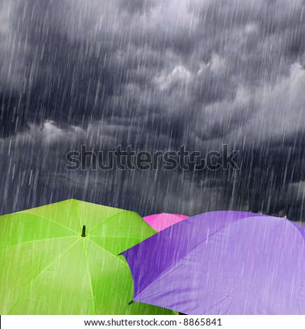 Color Umbrellas in Rainy Storm Clouds - stock photo