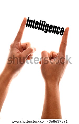"Color vertical shot of a hand squeezing the word ""intelligence""."