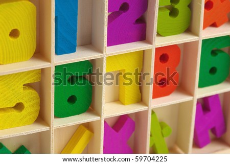 Color wooden toy figures in a box close up - stock photo