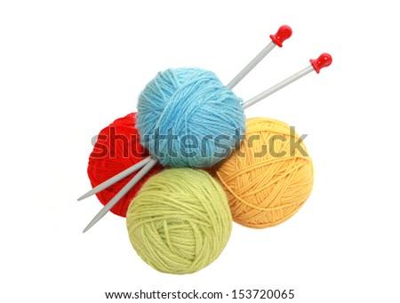 Color yarn balls and knitting needles - stock photo