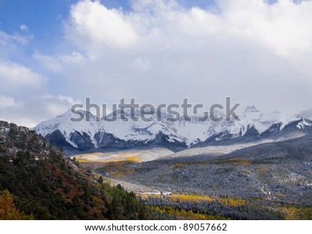 Colorado Aspens with snow capped mountain view in the background. - stock photo