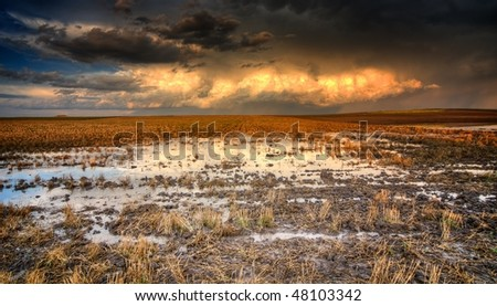 Colorado farmland flooded after a severe storm. - stock photo