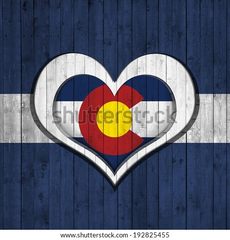colorado flag  heart and wood background - stock photo